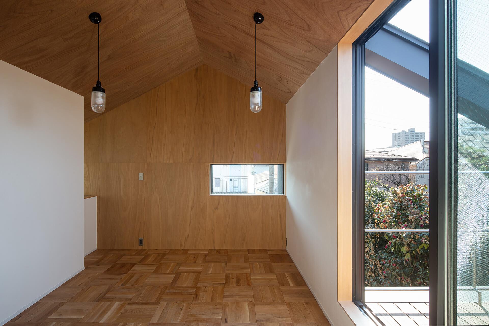 江古田K邸 寝室とラワン壁
